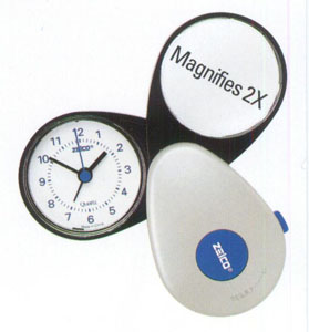 magnified face travel alarm clock